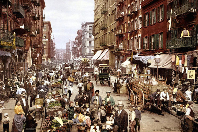 people in streets of new york city a century ago