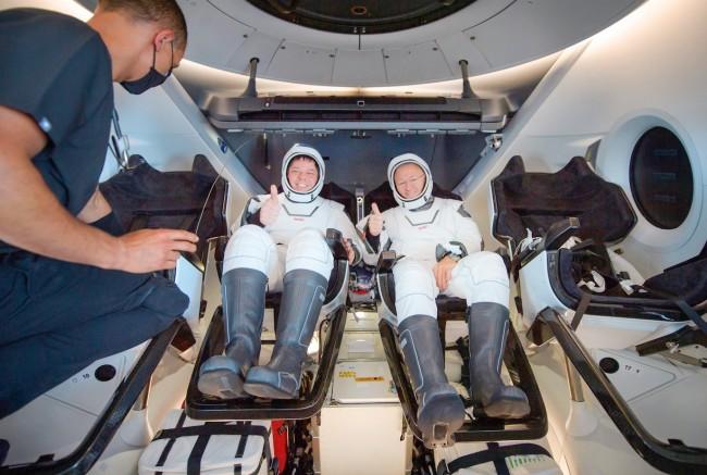 thumbs up Doug Hurley Robert Behnken NASA