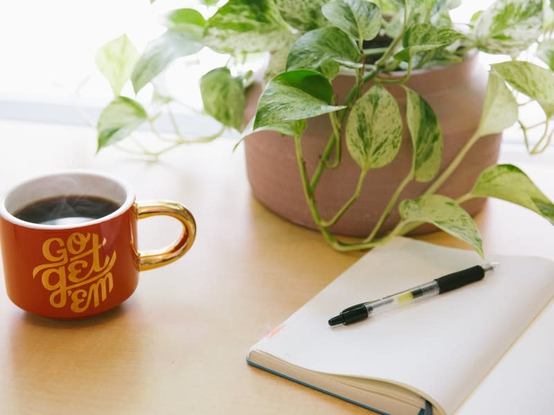 Image of coffee mug with phrase Go get 'em next to a to-do list