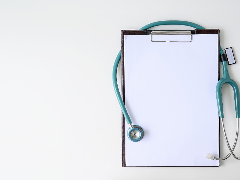 Clipboard with turquoise stethoscope