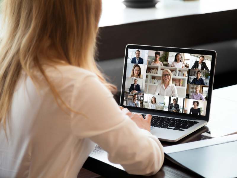 Professional woman video conferencing with colleagues