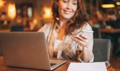 woman working on laptop using mobile coffee shop 470x280