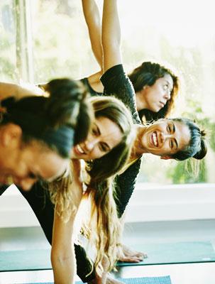 group doing yoga 303x400