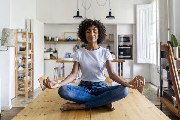 Woman on table meditating (Blog: 600x400)