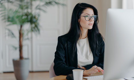 business woman looking at computer