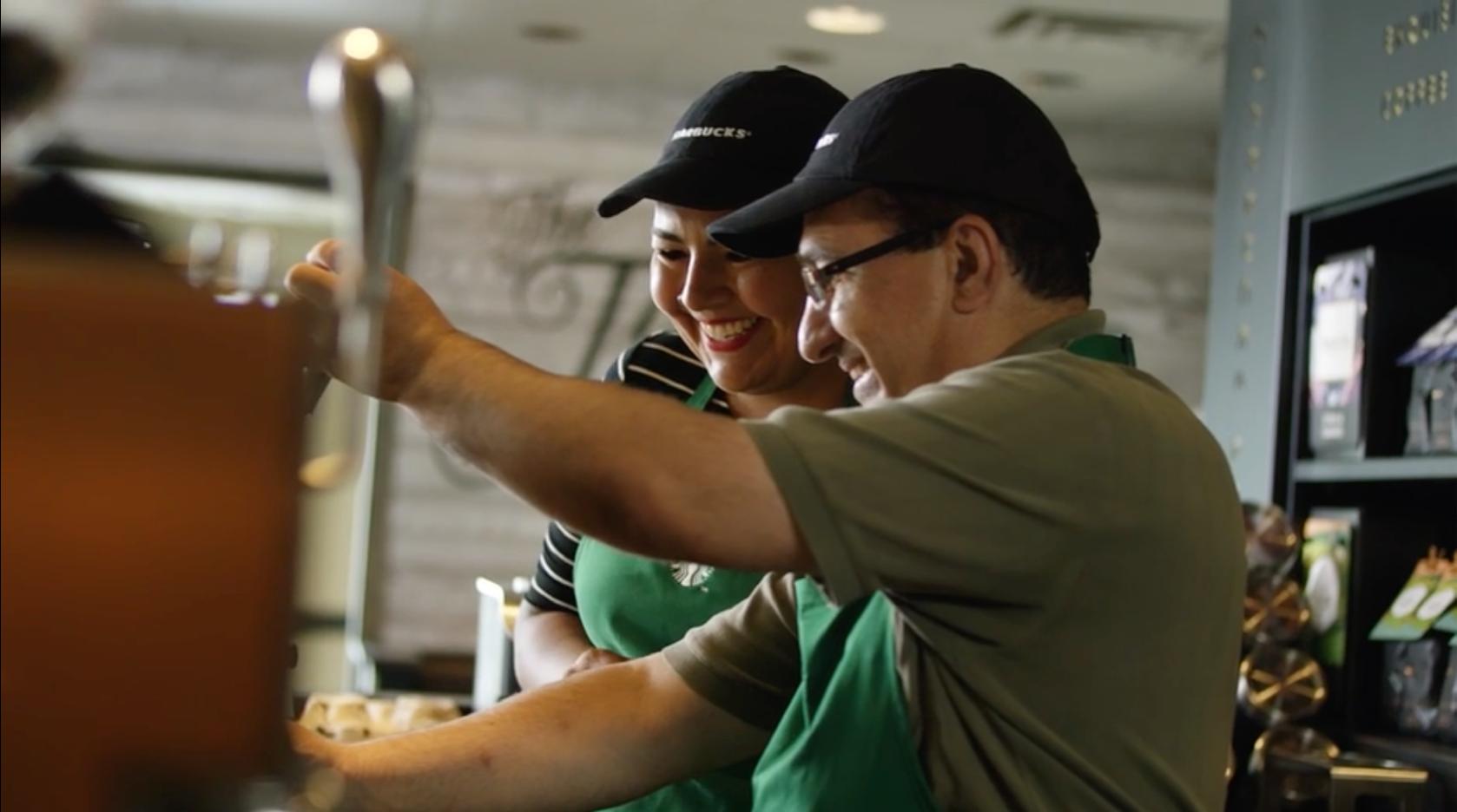 Starbucks employees making espresso.