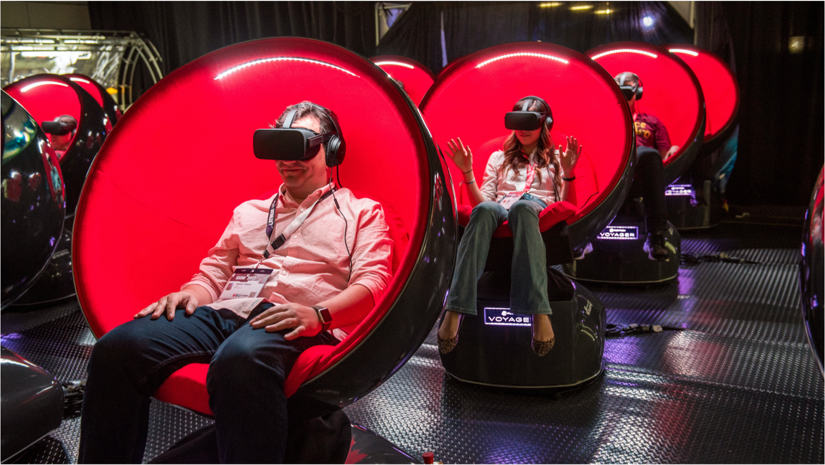 People sitting in red chairs in a virtual re