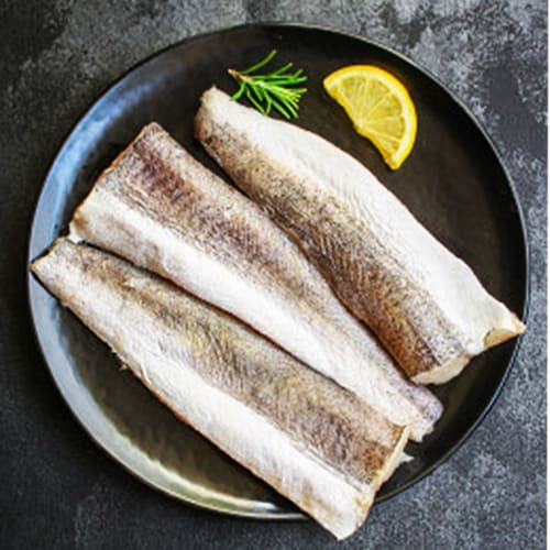 White fish on a plate with lemon and rosemary