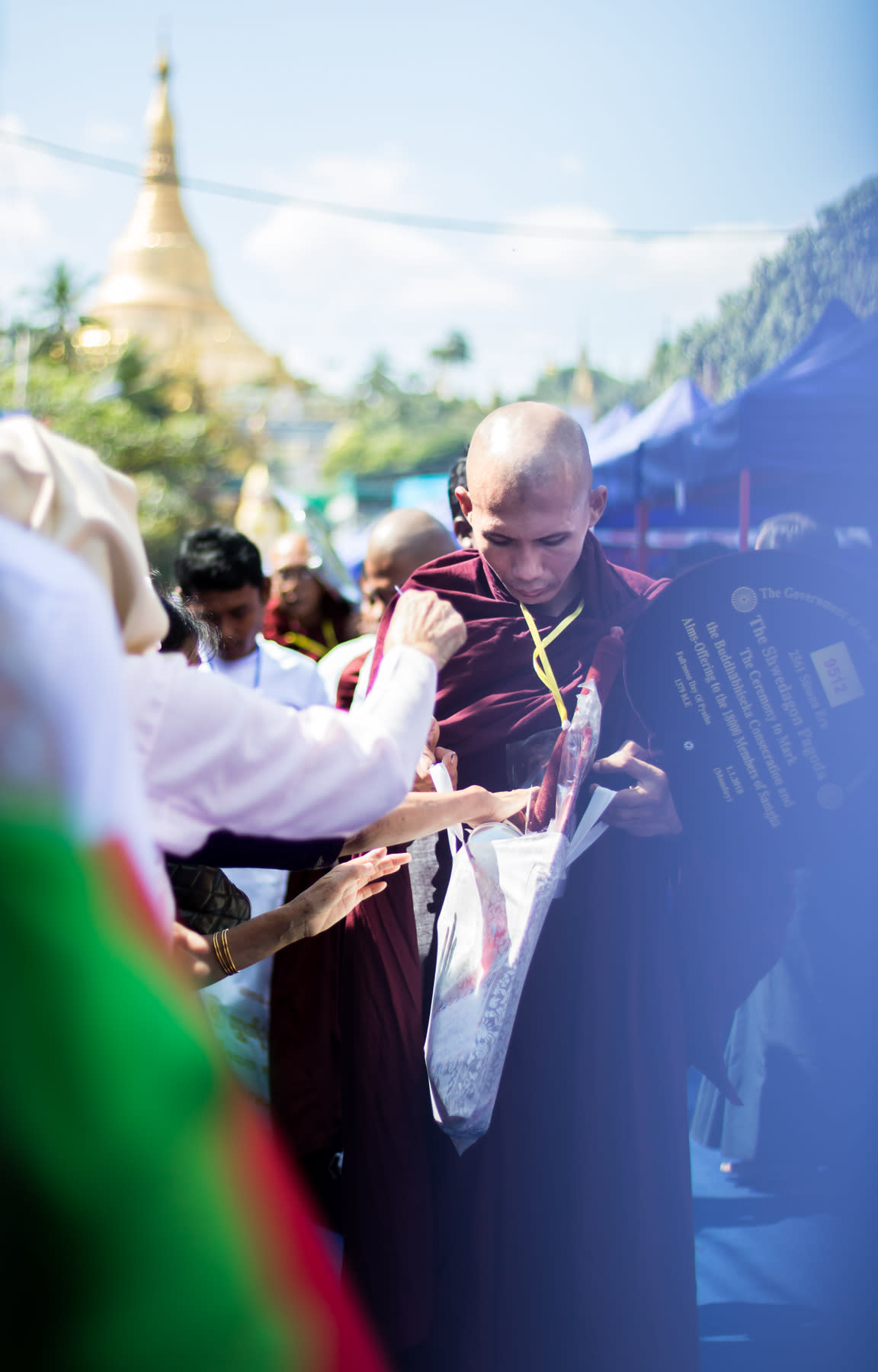 Monk receiving donation in front of Shwedagon Pagoda
