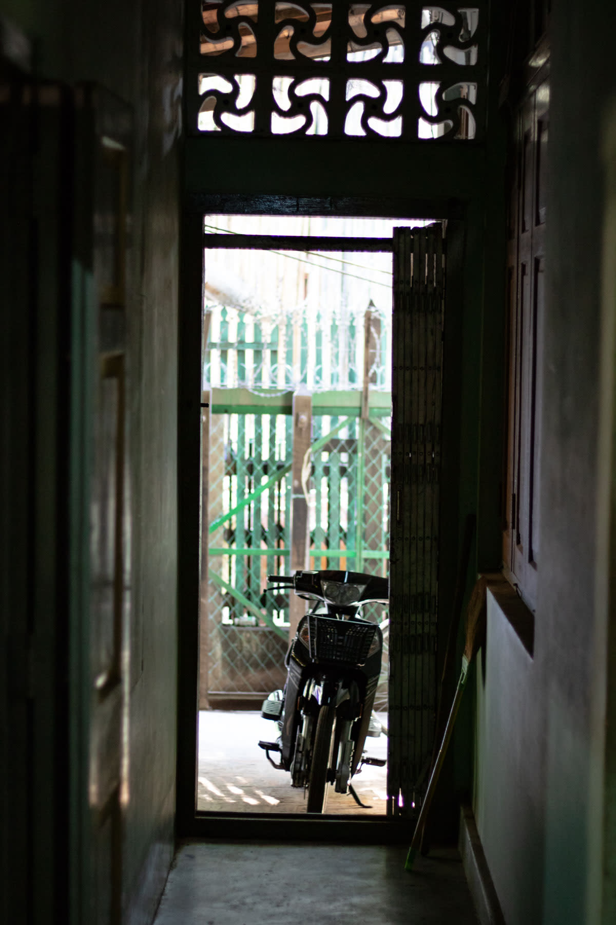 A motorbike leaning on a doorway