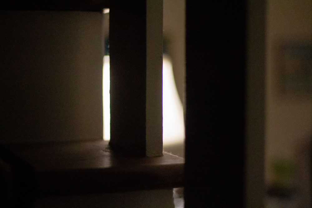 Silhouette of staircase in front of lamp