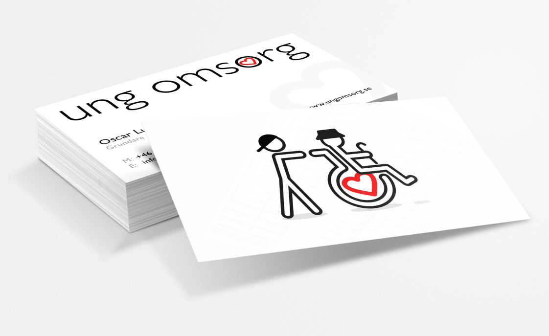 White business cards featuring boy pushing an old man in a wheelchair. The wheel of the wheelchair has the heart icon from the logotype.