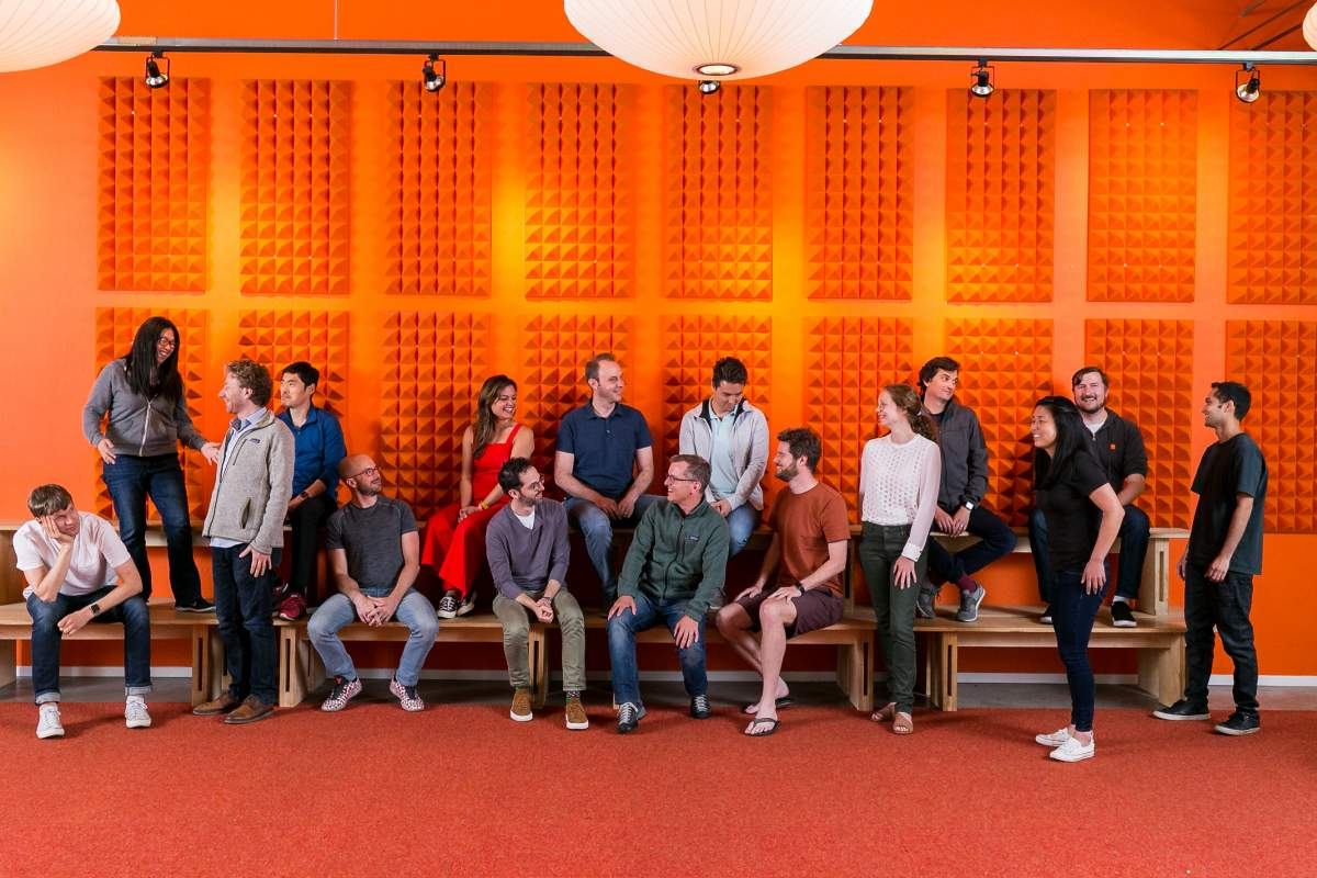 Y Combinator team with an orange background