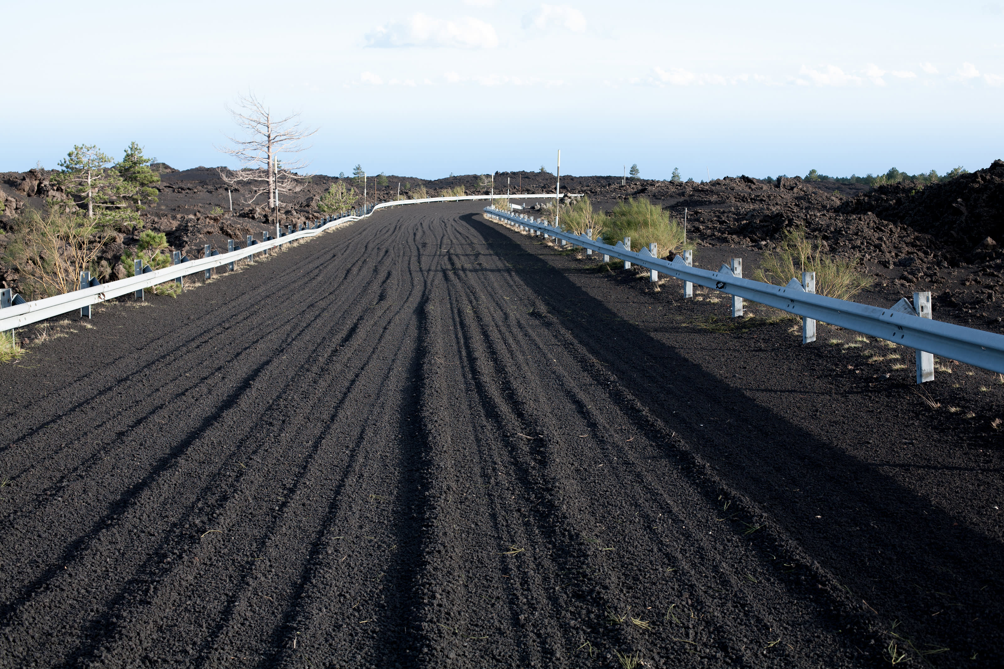 effects of Etna's eruptions on surrounding landscapes.