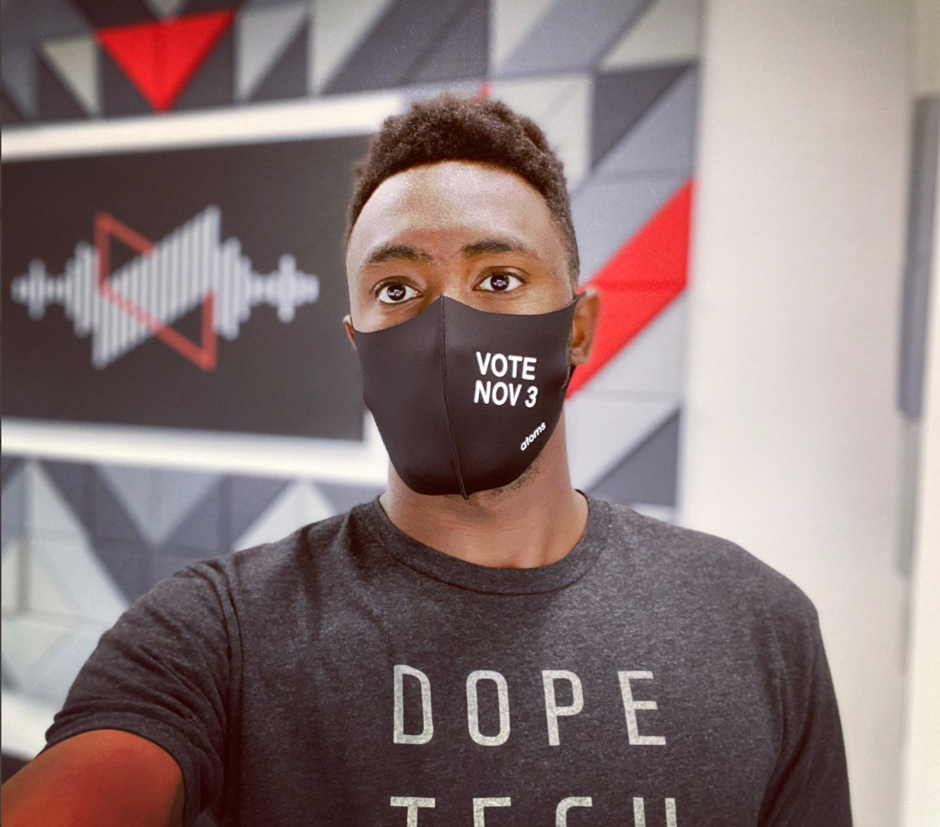 MKBHD host Marques Brownlee in his VOTE NOV 3 Atoms mask.
