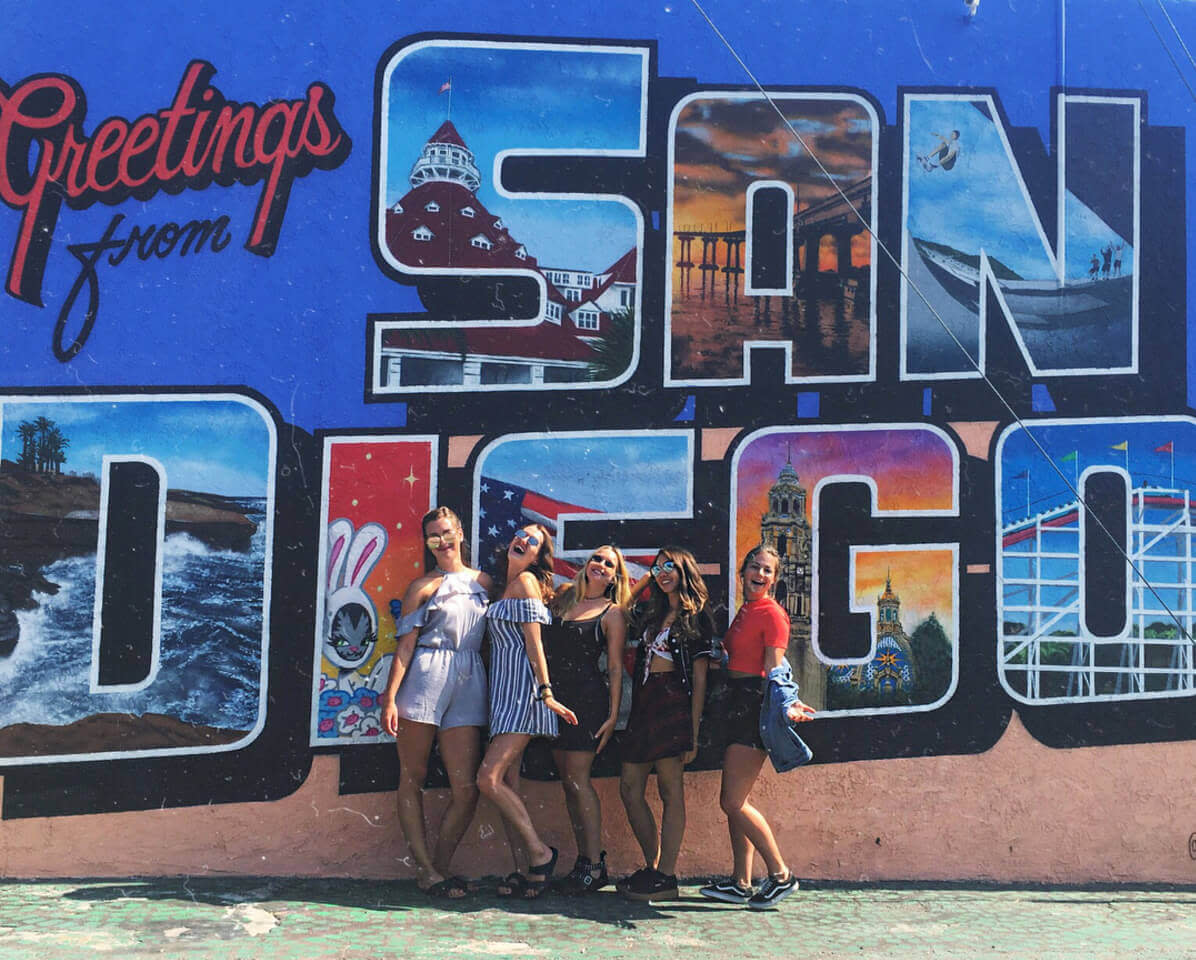 Pictured on the left: a group of au pair friends visiting sunny San Diego