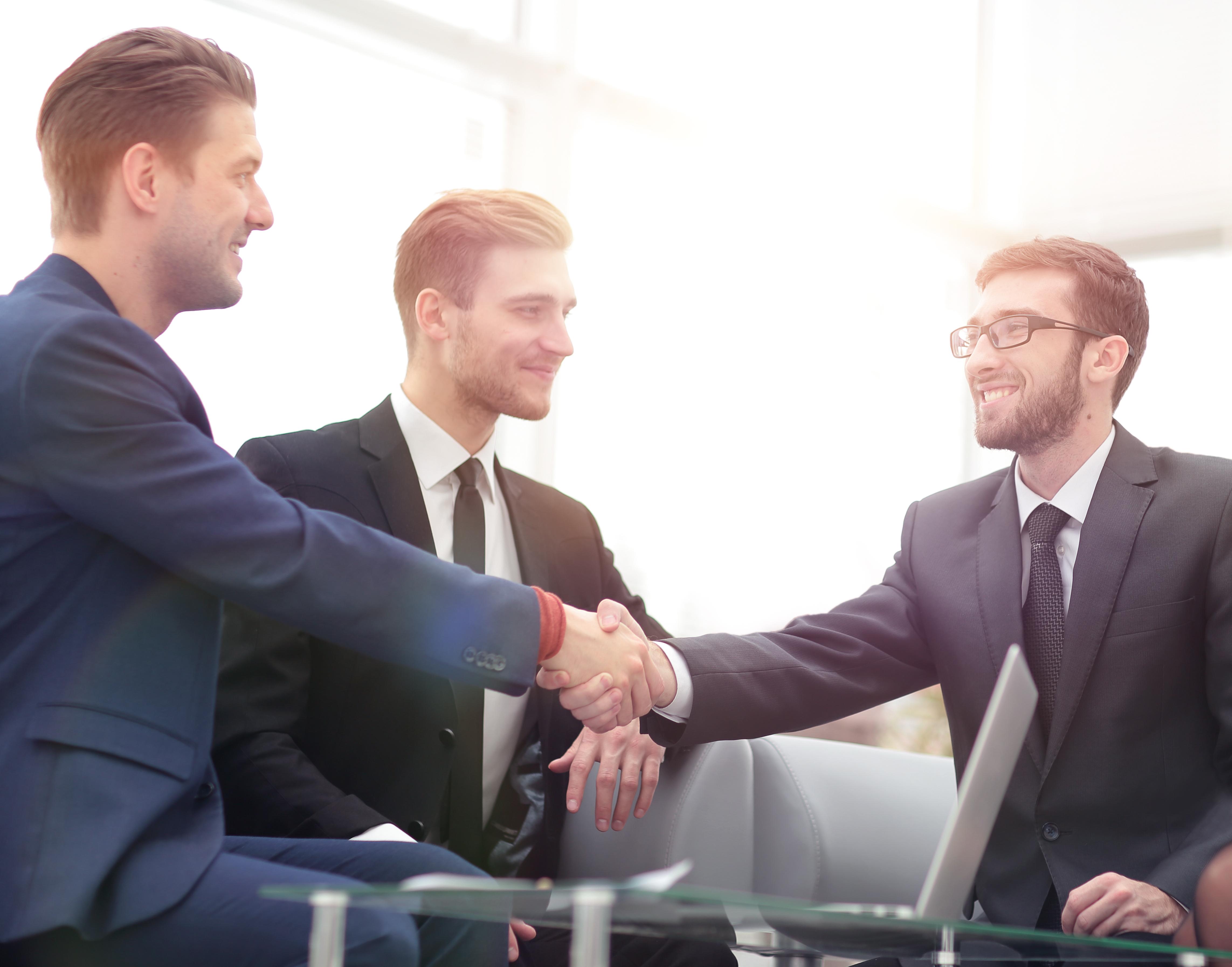 Geschäftsmeeting Handshake