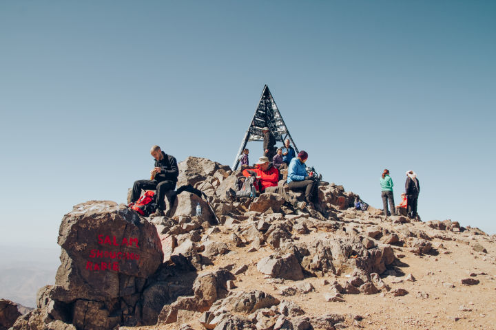 Taking a break on a rocky summit