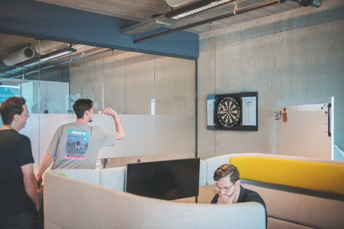 People in a office playing darts