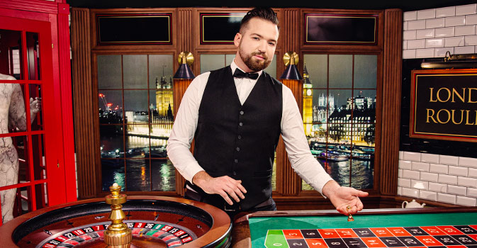 Croupier dealing cards at the top live dealer online casino in March 2020