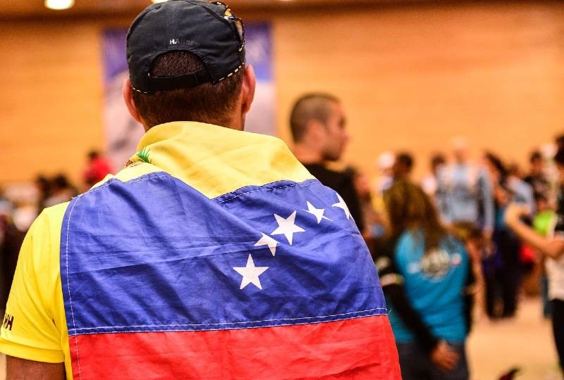 Man Covered With A Venezuelan Flag