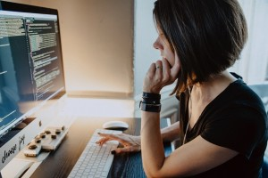 Woman looking at code on computer