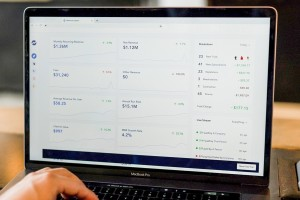 Person with laptop reviewing data analytics dashboard