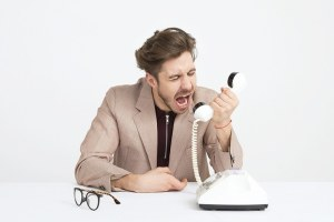 Young professional yelling at his phone