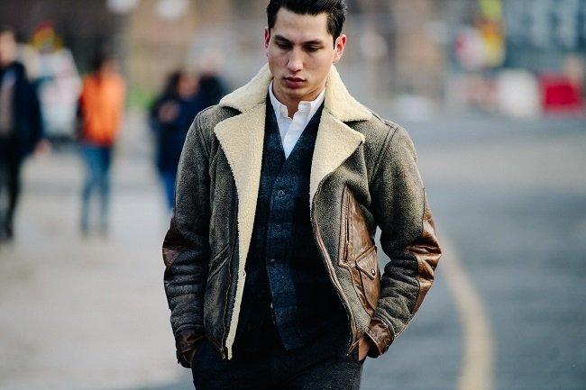 man on street in sheepskin jacket
