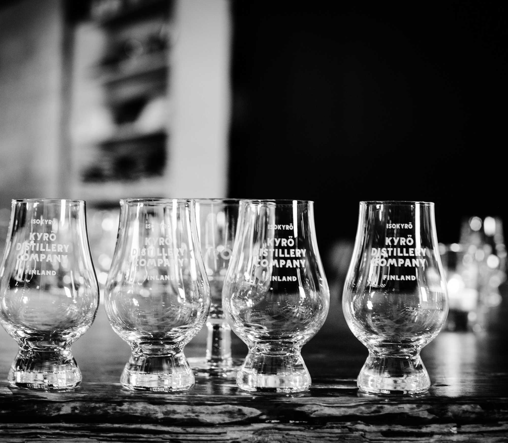Empty Glencairn tasting glasses with Kyrö Distillery logo