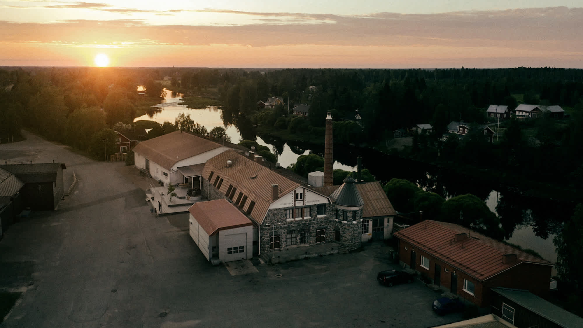 Image of Kyrö Distillery from above during sunset.