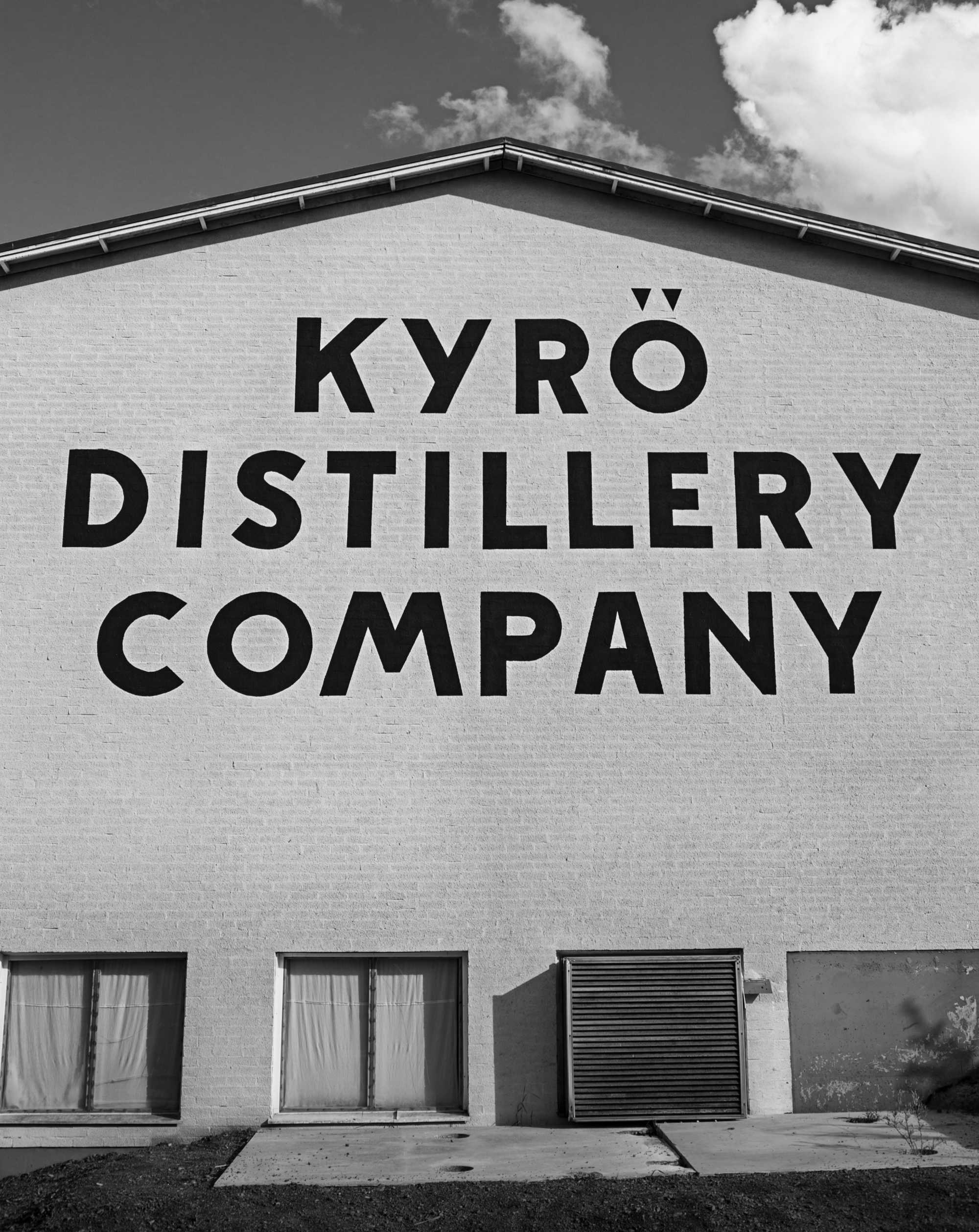 Kyrö Distillery Company logo on the wall of the distillery