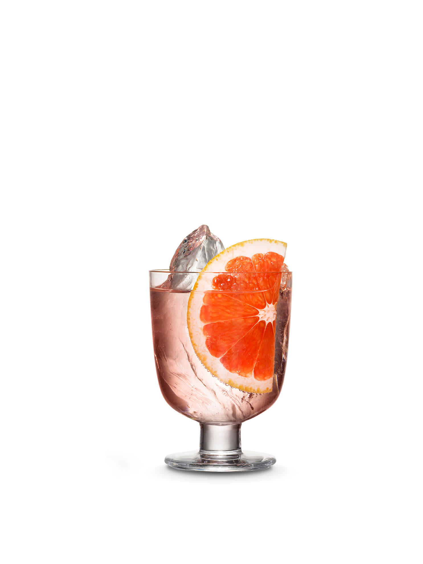 A bottle of Kyrö Pink Gin next to the perfect serve, in an Iittala cocktail glass, hand-cut shards of ice, and a slice of blood orange. Photo by KoskiSyväri.