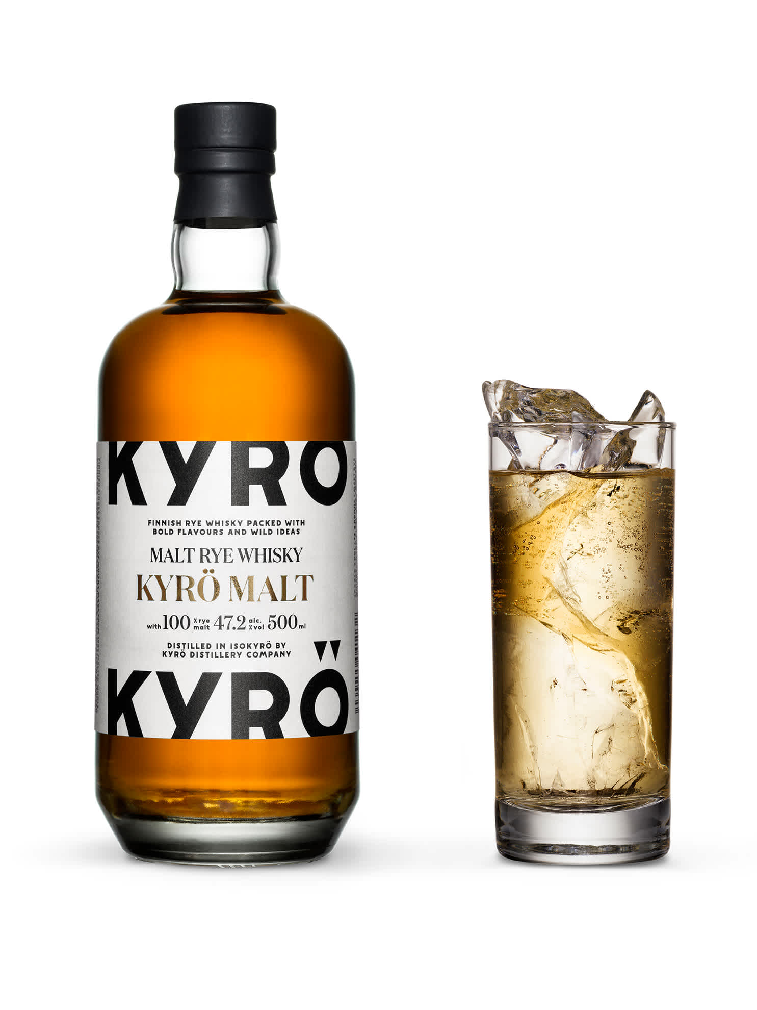 500ml bottle of Kyrö Malt Rye Whisky next to a highball glass filled with hand-cut shards of ice, soda water, lemon zest, and whisky. Vertical.