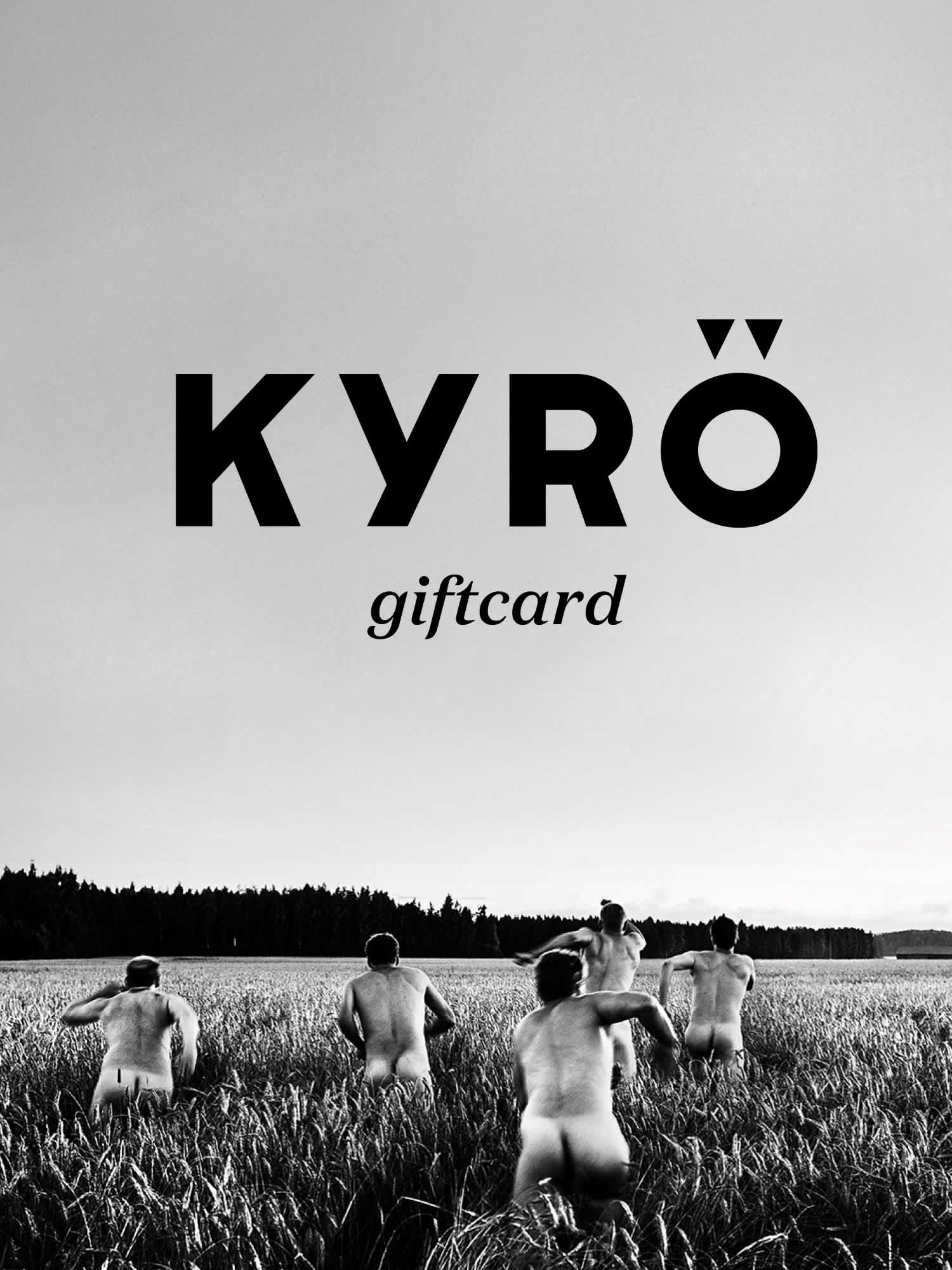 Black and white image of the five Kyrö founders running naked across a rye field. Kyrö logo displayed on top.