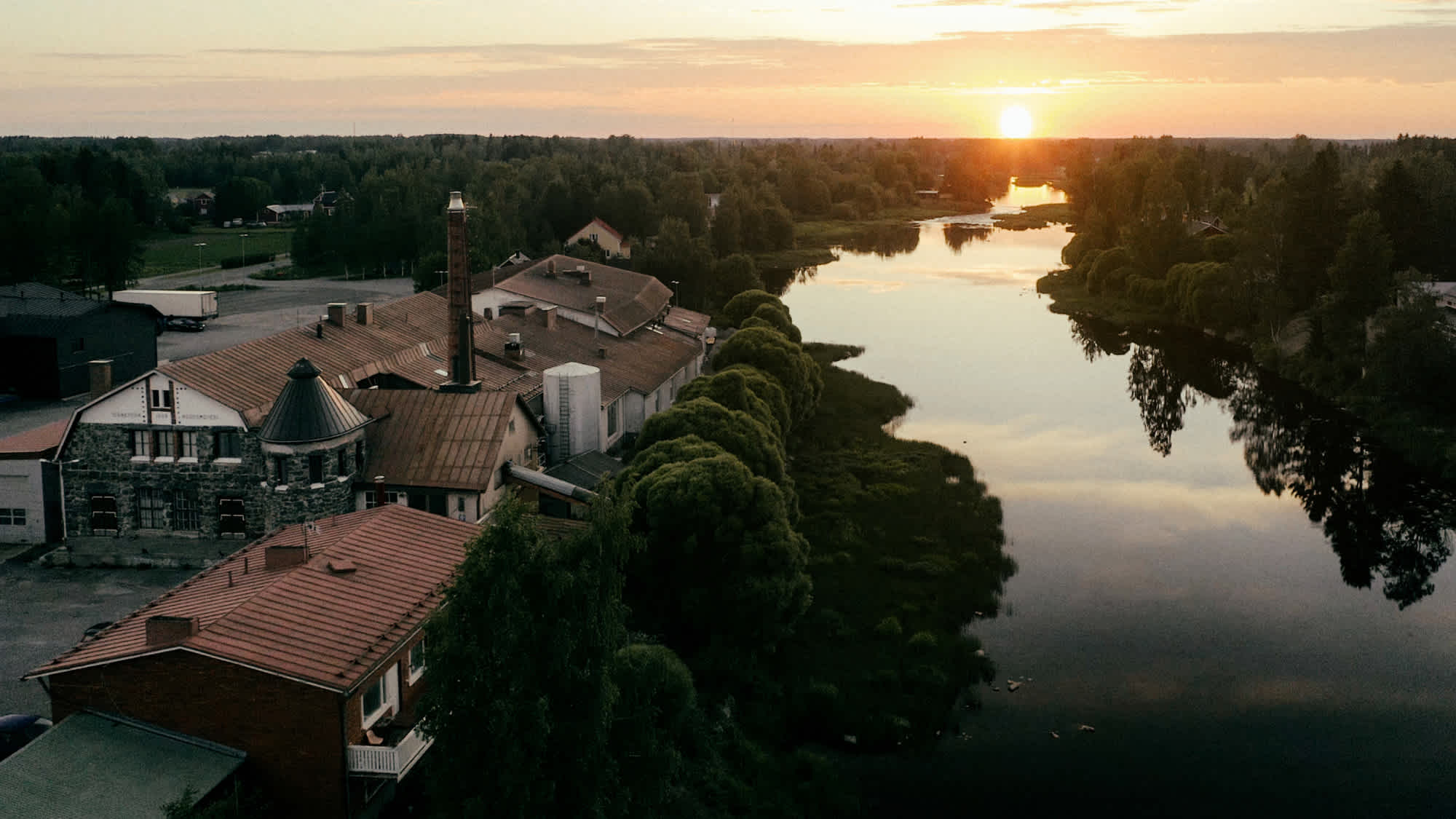 View of Isokyrö and Kyrö Distillery from above with a sunset.