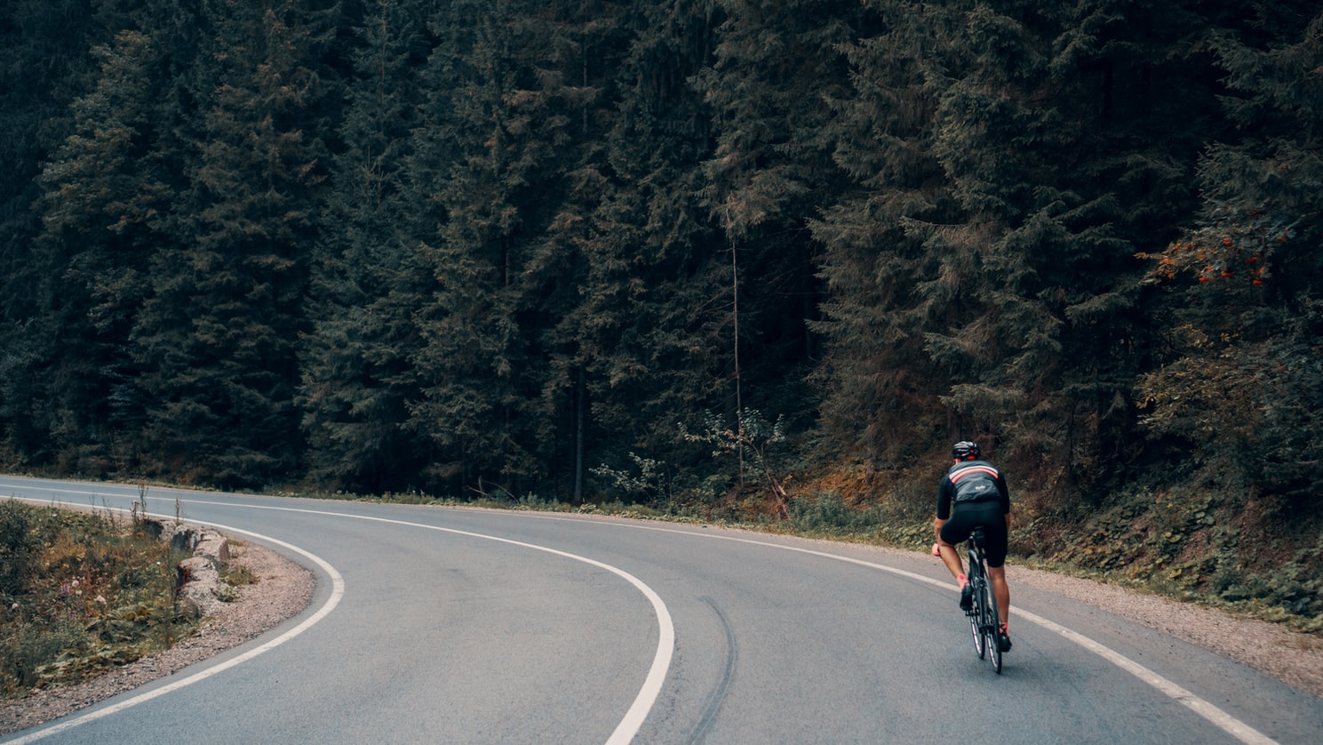 Man cycling through the hills