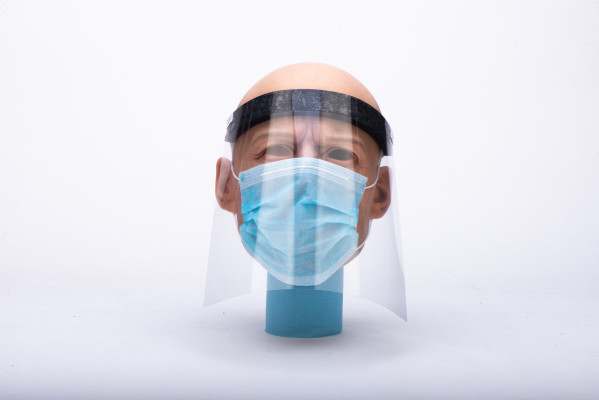 A mannequin wearing a face shield and surgical mask front view
