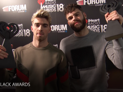 chainsmokers holding the iheart radio award
