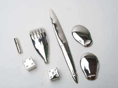 A group of metal plated utensils and dice