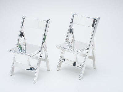 Two metal plated chairs