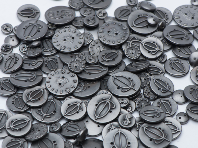 A lot of metal plated clothes buttons