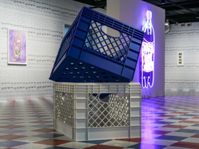 A blue fabricated bodega crate on top of a white fabricated bodega crate