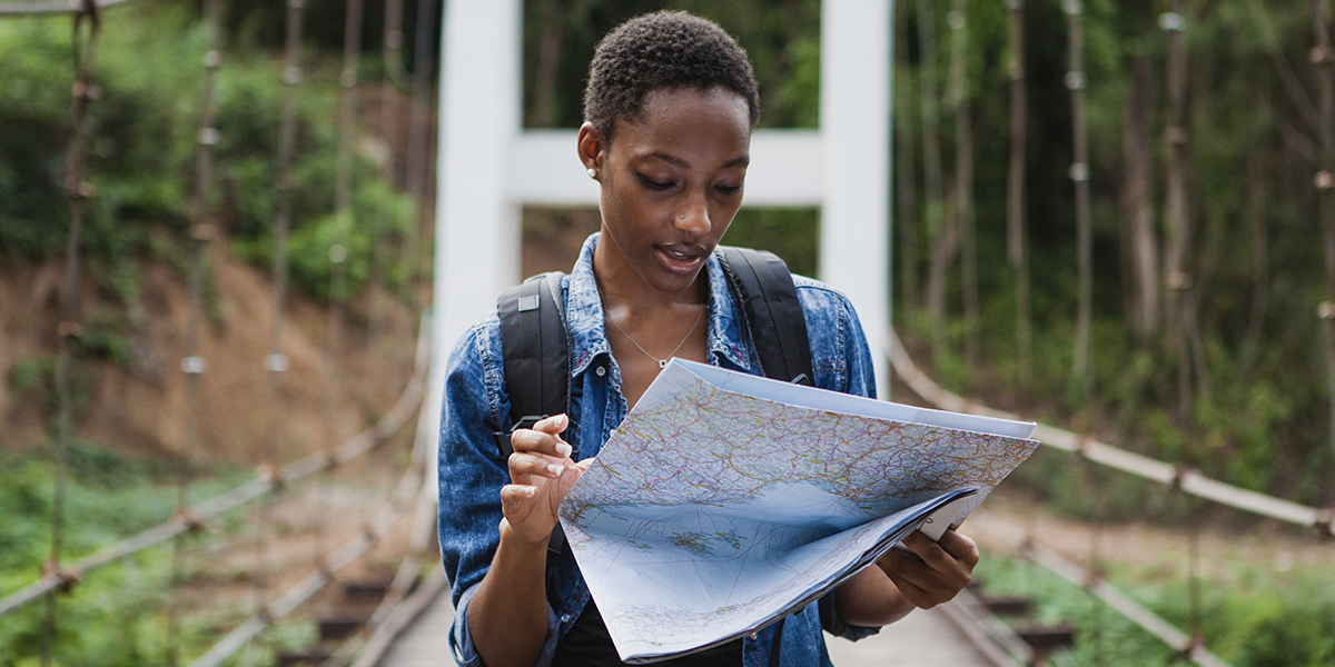 Woman using map to get somewhere