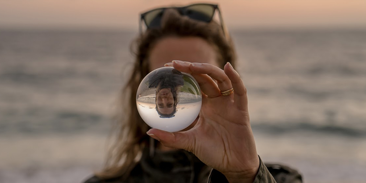 Woman looking into glass ball