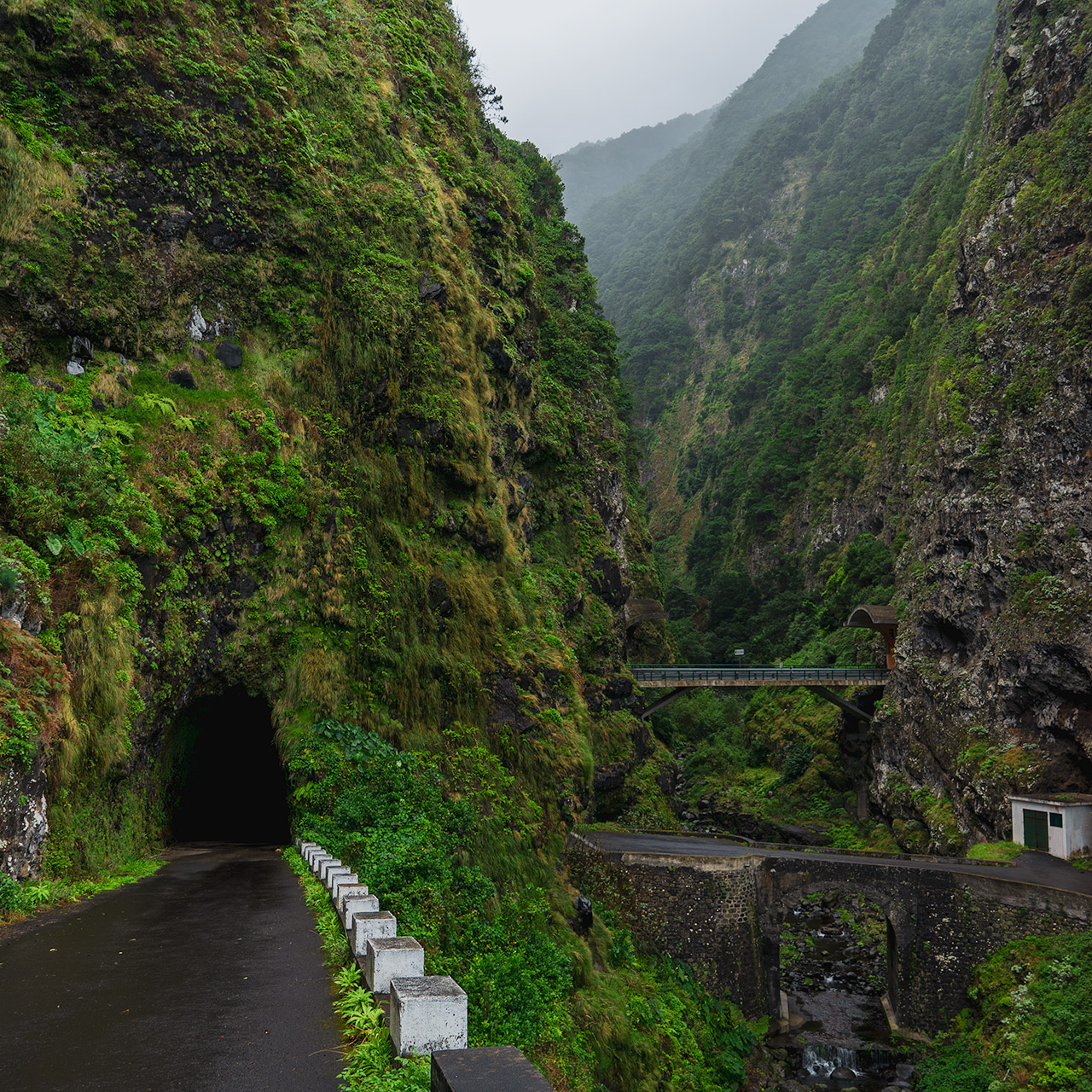 The old road and two-way tunnel on the North coast of Madeira. Some of the older roads are in a very bad state and closed, but this one was open for traffic.