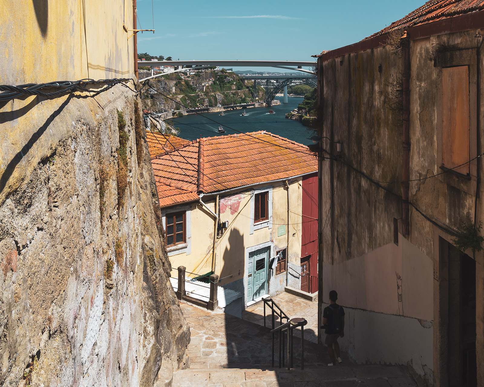 Porto old town alley and view of the Ponte Infante Dom Henrique