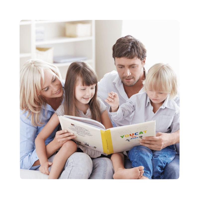 family of four reading the youcat for kids book