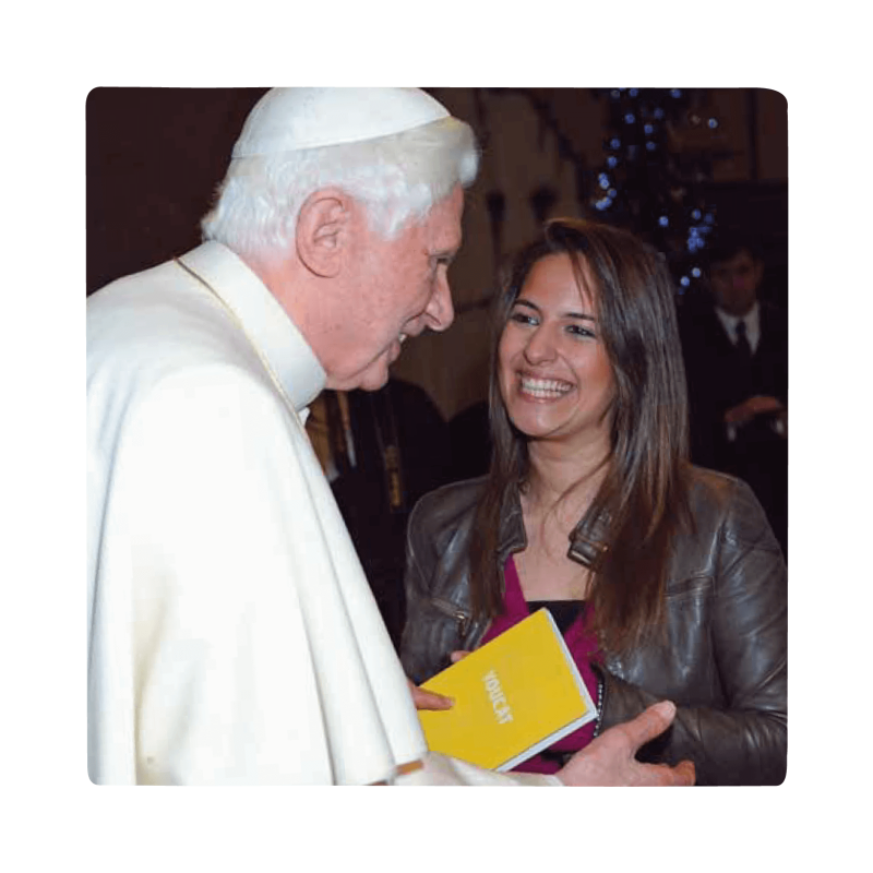 pope discussing youcat book with catholic girl