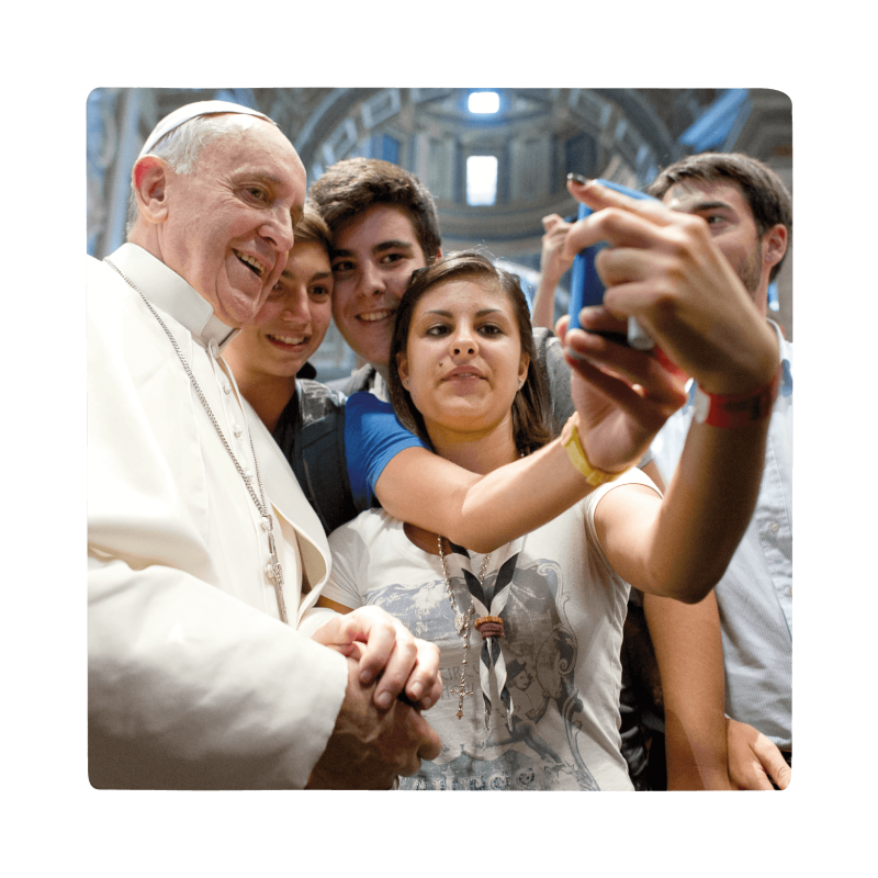 Pope with young catholics reading the docat app